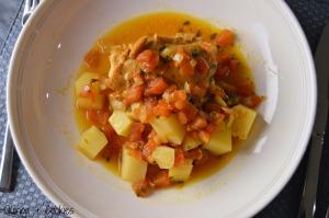 Chicken, potatoes, and tomatoes in broth.  Mmmmmmm.